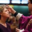 Carol Fairhurst, a member of St. Pius Catholic Church in Coeur d'Alene, Idaho, receives an ash cross on her forehead from Rev. Francisco Godinez, Wednesday, Feb. 22, 2012 during Ash Wednesday services. Ash Wednesday marks the beginning of the Lent season which lasts 40 days. (AP Photo/Coeur d'Alene Press, Shawn Gust)