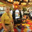 FILE - In this Aug. 24, 2013 file photo, Black Oak Casino general manager Ron Patel walks the nearly empty gambling room floor due to the nearby fires in Tuolomne City, Calif. It doesn't pay to be a dateline in a disaster story, as the folks around Groveland, Calif. will tell you. On what would have been the busiest weekend of the summer had the Strawberry Music Festival not been cancelled, hotel rooms are empty and the local coffee roaster got rid of all 6 employees because the road to Yosemite is closed. One hotelier has had $20,000 in cancellations just this week. In the park, tourists are enjoying elbow room as hard-to-get campsite and lodging rooms are full but day tourists are staying away out of fear of fire and smoke. (AP Photo/The Modesto Bee, Elias Funez, File)