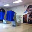 Voting machines are set up in front of a mural of President Barack Obama that was left uncovered on Election Day at the Benjamin Franklin Elementary School polling location in Northeast Philadelphia Tuesday, Nov. 6, 2012. Republicans complained and a local judge ordered the mural covered. (AP Photo/The Philadelphia Inquirer, Kristen Graham) PHIX OUT; TV OUT; MAGS OUT; NEWARK OUT
