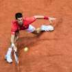 Serbia's Novak Djokovic returns the ball during the Davis Cup World Group first round match against Belgium's Olivier Rochus at the Spriroudome in Charleroi, Belgium, Friday Feb. 1, 2013. Serbia leads 1-0. (AP Photo/Geert Vanden Wijngaert)