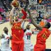 Spain's Pau Gasol (4) jumps to score over United States' LeBron James (6) and Carmelo Anthony (15) during the men's gold medal basketball game at the 2012 Summer Olympics  in London on Sunday, Aug. 12, 2012. (AP Photo/Mark Ralston, Pool)