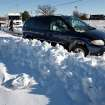 Cars stuck in deep snow drifts on Britton Road. Many spent Christmas Day, Dec. 25, 2009,  digging out from record snow storm that dumped 14 inches of snow in the Oklahoma City area.   Photo by Jim Beckel, The Oklahoman