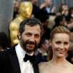 Judd Apatow, left, and Leslie Mann arrive before the 84th Academy Awards on Sunday, Feb. 26, 2012, in the Hollywood section of Los Angeles. (AP Photo/Matt Sayles) ORG XMIT: OSC369