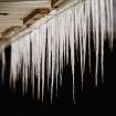 Icicles of varying lengths hang from an awning in front of  a row of small shops on NE 23rd Street near the state Capitol Thursday, Feb. 3, 2011. Photo by Jim Beckel, The Oklahoman