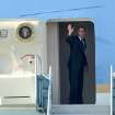 President Barack Obama waves as he boards Air Force One at San Francisco International Airport, Tuesday, Oct. 9, 2012, in San Francisco, enroute to Ohio then onto Washington. (AP Photo/Noah Berger)