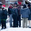 CORRECTS TO THREE PEOPLE DEAD NOT FIVE Friends and family members console each other, Tuesday, Dec. 25, 2012 in Flint, Mich. Michigan authorities say three people are dead in Flint from what is believed to be accidental carbon monoxide poisoning. (AP Photo/Flint Journal, Griffin Moores)
