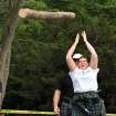 Sarah Densmore of Oklahoma City participates in the Caber Toss event during the Iron Thistle Festival in Yukon, Saturday, April 28th, 2012. PHOTO BY HUGH SCOTT, FOR THE OKLAHOMAN  ORG XMIT: KOD