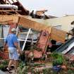 Johnny Hannah surveys damage to the back of his home on the Cedar Valley East Golf Course after a tornado came through the area Tuesday afternoon,  May 24, 2011,   He and his wife , Beth, were in the storm shelter when the tornado hit. Photo by Jim Beckel, The Oklahoman