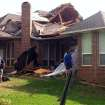 Residents of Edmond, Okla., survey storm damage from a tornado that hit their neighborhood Sunday, May 19, 2013. Forecasters had warned that the middle of the country would see severe weather throughout the weekend. (AP Photo/Sean Murphy)
