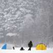 A Belarusian fisherman walks across the frozen lake during snowfall on the outskirts of the capital Minsk, Belarus, Thursday, Jan. 17, 2013. The heavy snowfall across Belarus began last night. (AP Photo/Sergei Grits)