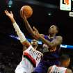 Portland Trail Blazers power forward LaMarcus Aldridge (12) comes in to block the shot of Phoenix Suns shooting guard Archie Goodwin (20) during the first quarter of an NBA basketball game on Wednesday, Nov. 13, 2013, in Portland, Ore. (AP Photo/Steve Dykes)