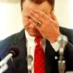 In this June 20, 1989 file photo, University of Oklahoma football coach Barry Switzer wipes his face during an emotional moment at a news conference where he announced his resignation in Norman, Okla. Twenty years later, Switzer says he no longer dwells on his tearful resignation as Oklahoma's football coach. The school had been hit by NCAA probation and player arrests. The resignation led to the Sooners' decade-long exile from college football's elite. (AP Photo/David Longstreath, File)