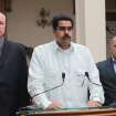 In this photo released by Miraflores Press Office, Venezuela's Vice President Nicolas Maduro, center, addresses the nation on live television flanked by Oil Minister Rafael Ramirez, left, and National Assembly President Diosdado Cabello at the Miraflores presidential palace in Caracas, Venezuela, Wednesday, Dec. 12, 2012.  Maduro said that Venezuela's President Hugo Chavez will face a