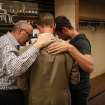 SPU President Dan Martin, center, prays with university trustee Matt Whitehead and Geoff Smith, right, in the Free Methodist church after a shooting at Seattle Pacific University on Thursday, June 5, 2014. A man that shot students was disarmed by others at the scene.  (AP Photo/seattlepi.com, Joshua Trujillo)