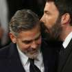 George Clooney, left, and Ben Affleck arrive for the BAFTA Film Awards at the Royal Opera House on Sunday, Feb. 10, 2013, in London. (Photo by Ki Price/Invision/AP)