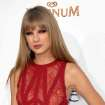 FILE - This May 20, 2012 file photo shows singer Taylor Swift at the 2012 Billboard Awards at the MGM Grand in Las Vegas, Nev. Swift joined several members of the Kennedy clan, including boyfriend Conor Kennedy, in a somber weekend visit to the grave of his mother on Cape Cod. Swift and Kennedy held hands and at one point appeared to bow their heads in prayer, as did his siblings, while visiting the resting place of Mary Richardson Kennedy on Sunday, Aug. 19. (Photo by John Shearer/Invision/AP, file)