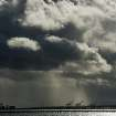 Storm clouds gather over Port of Oakland cranes as viewed from Berkeley, Calif., Monday, Nov. 9, 2015. A storm crossed the region Monday morning, bringing rain, thunder and lightning to the drought-parched region. (AP Photo/Noah Berger)