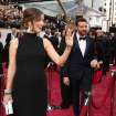 Olivia Wilde, left, and Jason Sudeikis arrive at the Oscars on Sunday, March 2, 2014, at the Dolby Theatre in Los Angeles.  (Photo by Matt Sayles/Invision/AP)