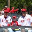 CIncinnati Reds' Mat Latos, left, and Nick Masset ride in a car during the Reds Opening Day baseball parade in downtown Cincinnati, Thursday April 5, 2012. The Reds open the season against the Miami Marlins later in the day. (AP Photo/Tom Uhlman)