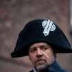 This undated publicity image provided by Universal Pictures shows Russell Crowe as Javert, center, in a scene from the motion-picture adaptation of