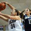 Notre Dame's Natalie Achonwa, right, blocks a shot by Connecticut's Kelly Faris during the first half of an NCAA college basketball game in Storrs, Conn., Saturday, Jan. 5, 2013. (AP Photo/Jessica Hill)