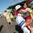 Jay Chan, of Oklahoma City, carries his niece Christine Somsack, age 4, through the midway at the 2009 Oklahoma State Fair at State Fair Park in Oklahoma City on Sunday, Sept. 27, 2009.  By John Clanton, The Oklahoman