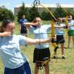 15 year old Australian camper Sharalee Fraser (front) takes aim the Philadelphia Youth Camp's archery range in north Edmond.  Community Photo By:  Aubrey Mercado - HWA College  Submitted By:  Shane, Edmond