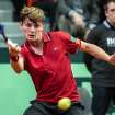 Belgium's David Goffin returns the ball during the Davis Cup World Group first round match against Serbia's Viktor Troicki at the Spriroudome in Charleroi, Belgium, Friday Feb. 1, 2013. (AP Photo/Geert Vanden Wijngaert)