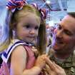 Eric Frazier holds his daughter Carley during the return ceremony for the National Guard's 45th Infantry Brigade Combat Team at the Army Aviation hanger at Will Rogers Air National Guard Base Sunday, March 25th, 2012. PHOTO BY HUGH SCOTT, FOR THE OKLAHOMAN