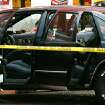 A car sits behind crime scene tape following a shooting outside an auto parts store on NW 23rd street on Monday, March 3, 2008. By John Clanton, The Oklahoman