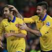 Arsenal's Mathieu Flamini, left, celebrates scoring this team's second goal with teammate Olivier Giroud during their English Premier League soccer match against Cardiff City in Cardiff, Wales, Saturday, Nov. 30, 2013. (AP Photo/Nick Potts, PA Wire)  UNITED KINGDOM OUT  -  NO SALES  -  NO ARCHIVES