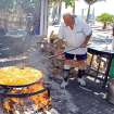 At Nerja, on Spain's Costa del Sol, there's a lunchtime seaside feast every day at Ayo's bar, where he cooks paella over an open fire. (Photo by Rick Steves)