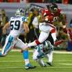 Atlanta Falcons running back Steven Jackson leaps over Carolina Panthers cornerback Melvin White for a first down in the first half of an NFL football game Sunday, Dec. 29, 2013, in Atlanta. (AP Photo/Atlanta Journal-Constitution, Curtis Compton)  MARIETTA DAILY OUT; GWINNETT DAILY POST OUT; LOCAL TV OUT; WXIA-TV OUT; WGCL-TV OUT
