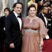 Ben Falcone, left, and Melissa McCarthy arrive before the 84th Academy Awards on Sunday, Feb. 26, 2012, in the Hollywood section of Los Angeles. (AP Photo/Matt Sayles) ORG XMIT: OSC145