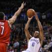 OKLAHOMA CITY THUNDER / PORTLAND TRAIL BLAZERS / NBA BASKETBALL  Oklahoma City's Russell Westbrook shoots a fallaway jumper over Portland's Brandon Roy during the Thunder - Portland game April 3, 2009 in the Ford Center in Oklahoma City.    BY HUGH SCOTT, THE OKLAHOMAN ORG XMIT: KOD