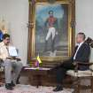 In this photo provided by Miraflores Presidential Press Office, Venezuela's Vice President Nicolas Maduro, left, is interviewed by Communications Minister Ernesto Villegas on state television in Caracas, Venezuela, Friday, Jan. 4, 2013. Maduro said President Hugo Chavez could be sworn in by the Supreme Court later on if he's not able to take the oath of office before lawmakers on Jan. 10 because of his struggle with cancer, dismissing the argument by some opposition leaders that new elections must be called if Chavez doesn't take office as scheduled on Thursday. Behind hangs a painting of Venezuela's independence hero Simon Bolivar. (AP Photo/Miraflores Presidential Office)