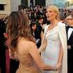 Kristen Wiig, left, and Gwyneth Paltrow arrive before the 84th Academy Awards on Sunday, Feb. 26, 2012, in the Hollywood section of Los Angeles. (AP Photo/Chris Pizzello) ORG XMIT: OSC332