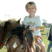 Bentley Freeman rides a pony Saturday at the Cleveland County Fairgrounds during the Pioneer Exhibition  Community Photo By:  Jenna McIntosh  Submitted By:  Jenna,