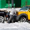 Oklahoma Highway Patrol Trooper Mike Roe pushes a motorist out of snow in a Midwest City parking lot. Many spent Christmas Day, Dec. 25, 2009,  digging out from record snow storm that dumped 14 inches of snow in the Oklahoma City area.   Photo by Jim Beckel, The Oklahoman
