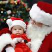 Randy Baas (cq) who has played Santa at the Red Andrews Dinner for 24 years, holds 3 month-old Mikey Sayerwinnie (cq) at the Cox Convention Center, Friday,  Dec. 25, 2009. Photo by Jim Beckel, The Oklahoman