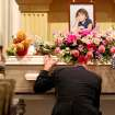 J.J. Johnson kneels in front of his daughter Aja Johnson's casket during her funeral at Vondel L. Smith and Son's South Colonial Chapel in Oklahoma City on Wednesday, April 7, 2010. Photo by John Clanton, The Oklahoman ORG XMIT: KOD