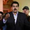 In this photo released by Miraflores Press Office, Venezuela's Vice-President Nicolas Maduro, center, accompanied by other members of the cabinet, spekas for Venezuelan Television at the presidential palace in Caracas, Venezuela, Tuesday, Dec. 11, 2012. Maduro said Chavez was recovering in Cuba after an operation targeting an aggressive cancer that has defied multiple treatments. The operation was