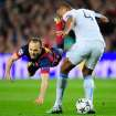 Barcelona's Andres Iniesta, left, falls in front of Manchester City's Vincent Kompany during a Champions League, round of 16, second leg, soccer match between FC Barcelona and Manchester City at the Camp Nou Stadium in Barcelona, Spain, Wednesday March 12, 2014. (AP Photo/Manu Fernandez)