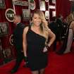 Mariah Carey arrives at the 20th annual Screen Actors Guild Awards at the Shrine Auditorium on Saturday, Jan. 18, 2014, in Los Angeles. (Photo by Matt Sayles/Invision/AP)