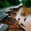 A portion of Briton Road between Sooner and Air Depot was washed away by flooding waters. Torrential rain caused flooding in Oklahoma City, Monday, June 14, 2010.     by Jim Beckel, The Oklahoman