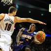 Phoenix Suns point guard Eric Bledsoe (2) drives to the basket against Portland Trail Blazers center Joel Freeland (19) during the first quarter of an NBA basketball game on Wednesday, Nov. 13, 2013, in Portland, Ore. (AP Photo/Steve Dykes)