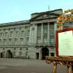 An easel stands in the forecourt of Buckingham Palace in London carrying an official document to announce the birth of a baby  boy, at 4.24pm to the Duke and Duchess of Cambridge at St Mary's Hospital,  Monday July 22, 2013. The child is now third in line to the British throne.  (AP Photo/John Stillwell, Pool)