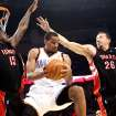Oklahoma City's Thabo Sefolosha looks for room in front of pressure from Toronto's Amir Johnson (left) and Hedo Turkoglu during their NBA basketball game at the Ford Center in Oklahoma City on Sunday, Feb. 28, 2010. Photo by John Clanton, The Oklahoman ORG XMIT: KOD