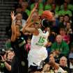 Notre Dame guard Lindsay Allen puts up a shot as Baylor guard Niya Johnson defends in the first half of their NCAA women's college basketball tournament regional final game at the Purcell Pavilion in South Bend, Ind Monday March 31, 2014. (AP Photo/Joe Raymond)