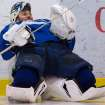 Vancouver Canucks' goalie Roberto Luongo stretches before an informal hockey practice with his teammates at the University of British Columbia in Vancouver, British Columbia on Friday Jan. 11, 2013. (AP Photo/The Canadian Press, Darryl Dyck)